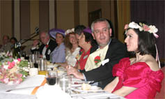 Dial M actors sitting with guests at a Dial M  murder mystery dinner
